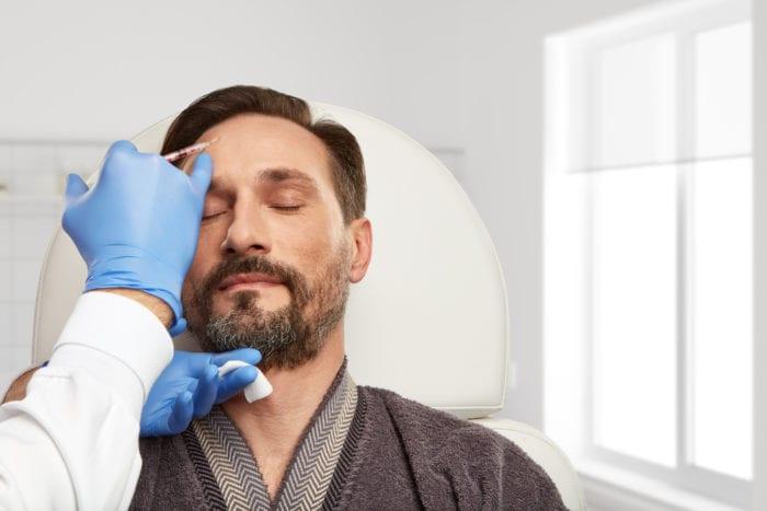 man doing botox treatment