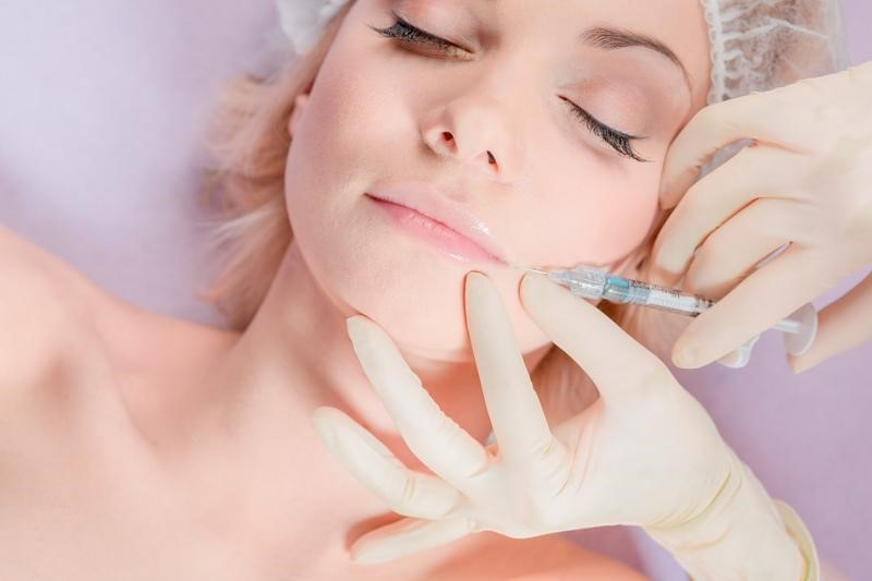 woman getting botox on lips