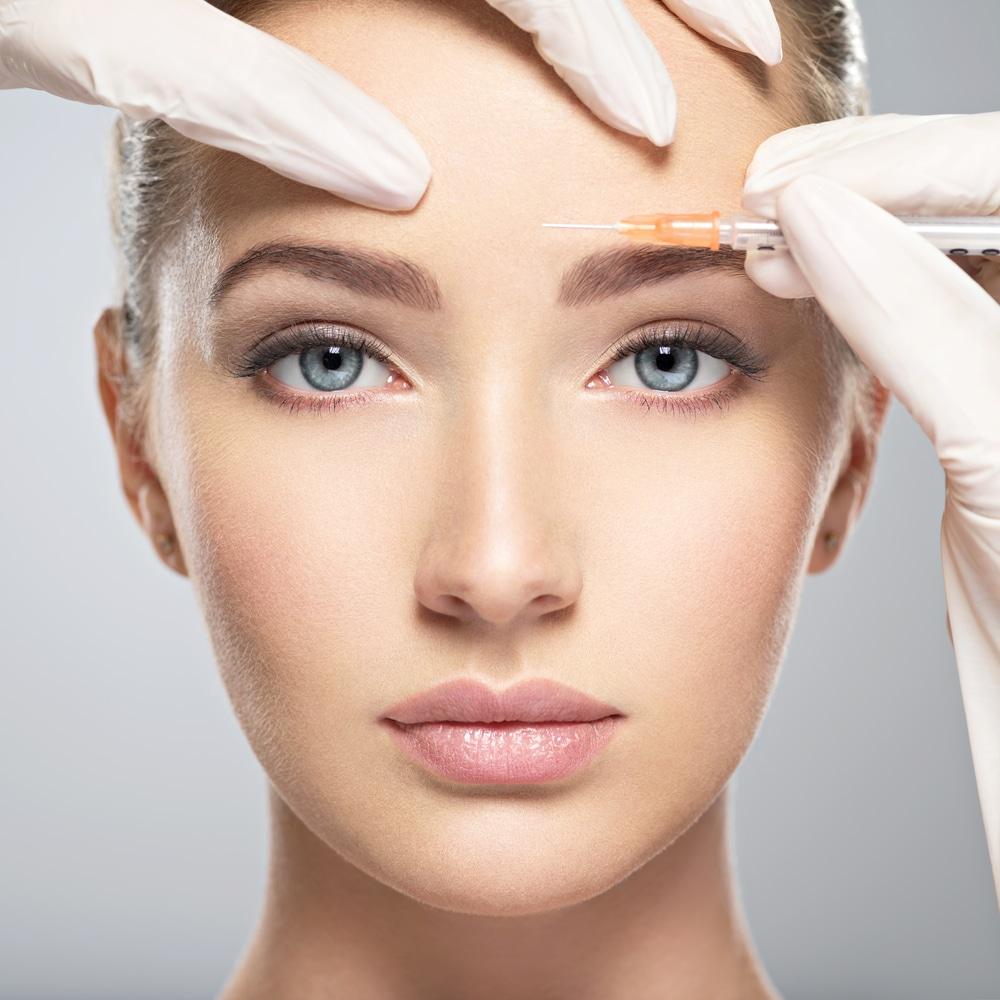 young caucasian woman getting botox